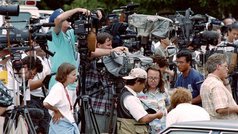 Photographers, television crews and reporters set up on July 31, 1996, in Atlanta, outside the apartment of Richard Jewell, a security officer who is being questioned in connection with the bombing at Olympic Centennial Park and is a prime suspect according to media reports. The FBI, in a search of Jewell's apartment, is reported to have taken several boxes. Jewell's attorney Watson Bryant said the search had turned up nothing