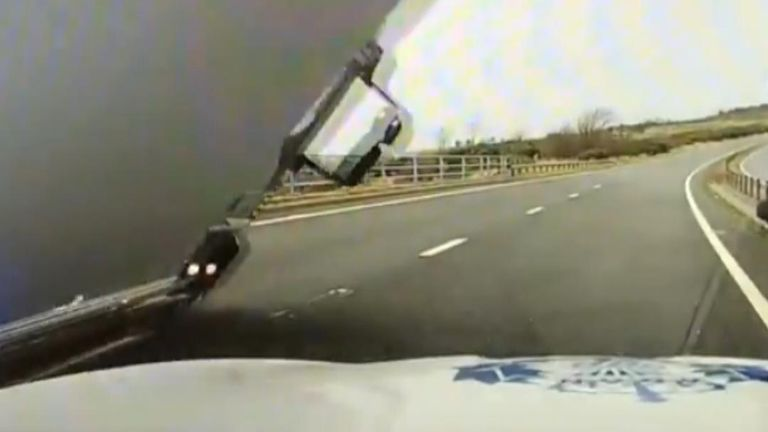 Lorry topples on to police car on A1