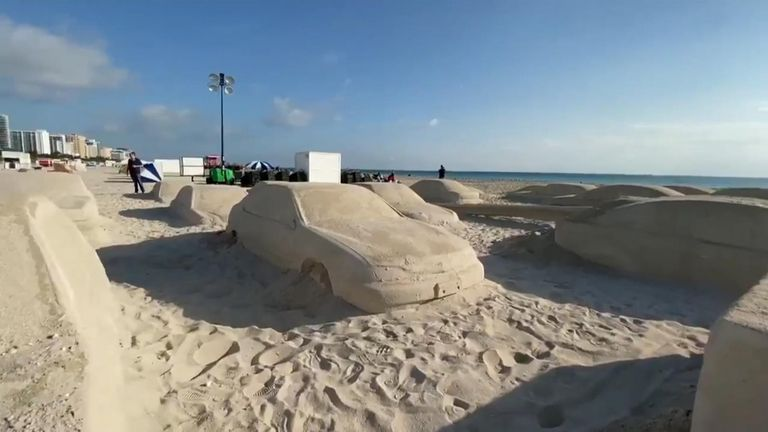 """Argentine conceptual artist Leandro Erlich put a new twist on the term """"traffic jam"""" after he made 66 sand sculptures of cars"""