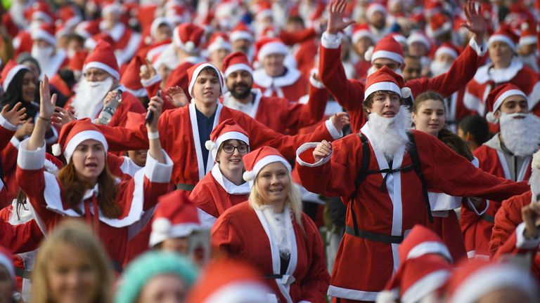 Around 3,000 people dressed in Santa suits dashed around Victoria Park