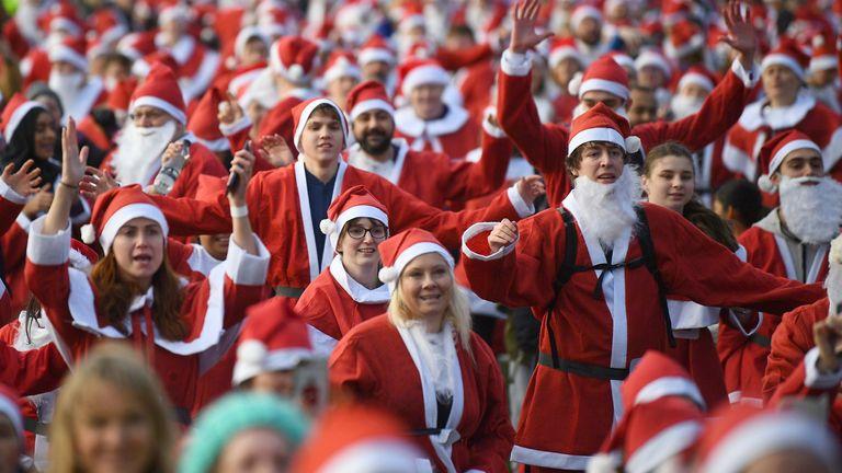 Around 3,000 people dressed in Santa suits dashed around Victoria Park