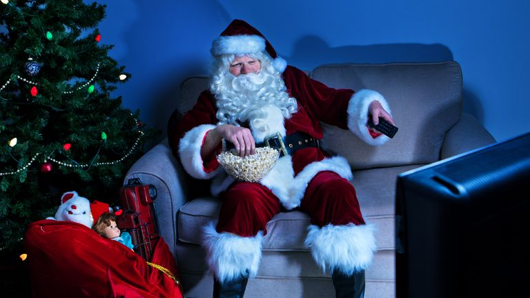 Santa Claus watches some television at Christmas