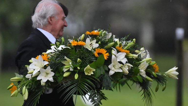 Flowers are carried into a memorial service for Saskia Jones