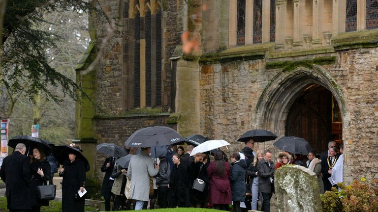 Mourners arrive at a memorial service for Saskia