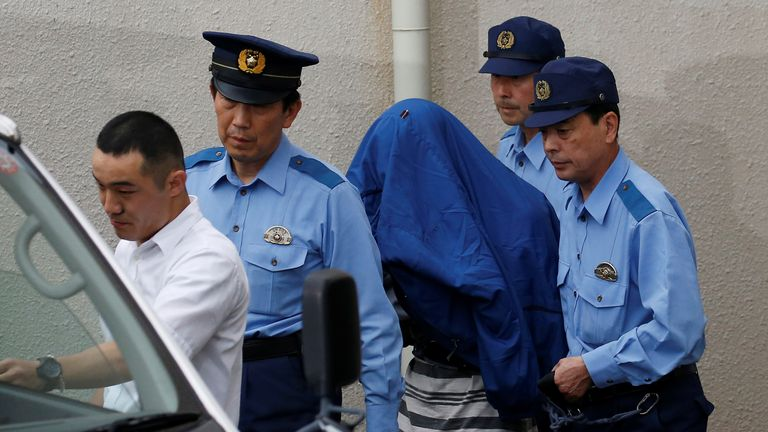 Satoshi Uematsu handed himself in at a police station after the killings
