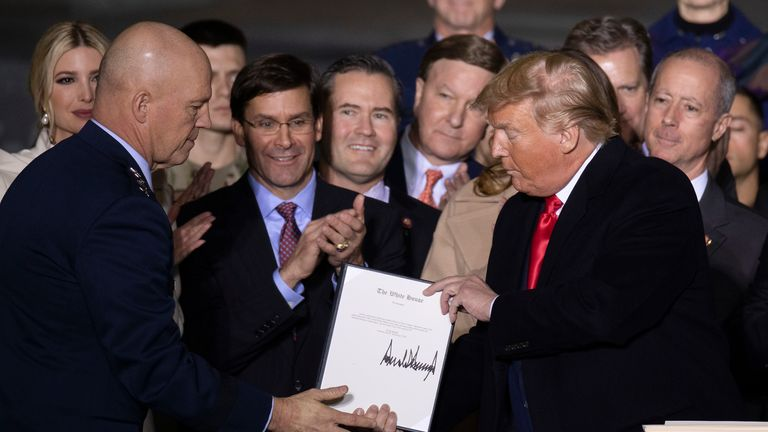 Donald Trump signs the National Defence Authorisation Act
