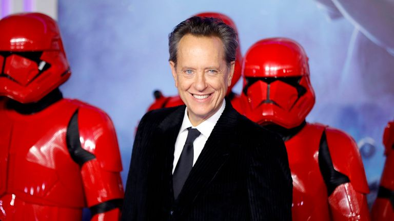 British actor Richard E. Grant (C) appears with sith stormtroopers on the red carpet at the European film premiere of Star Wars: The Rise of Skywalker in London on December 18, 2019.