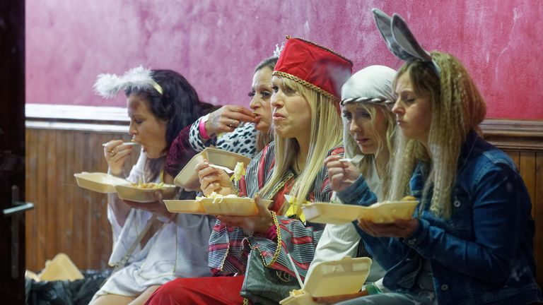 A group of women dressed as characters of the Nativity play, eat a take away meal on the last Friday before Christmas