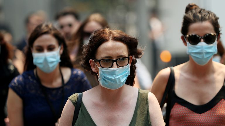 People are wearing face masks to protect from smoke haze in Sydney, Australia on 5 December