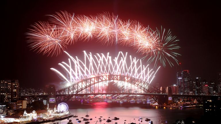 SYDNEY, AUSTRALIA - JANUARY 01: Fireworks light up the sky above Sydney Harbour during the midnight fireworks display during New Year's Eve celebrations on January 1st, 2020 in Sydney, Australia. (Photo by Cameron Spencer/Getty Images)