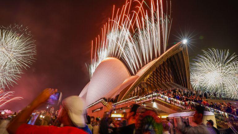 Fireworks explode over the Sydney Harbour Bridge and Sydney Opera House