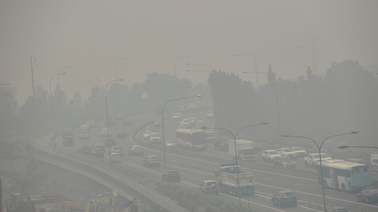 Smoke haze is seen along Victoria Road as the air quality index reaches as higher than ten times hazardous levels in some suburbs
