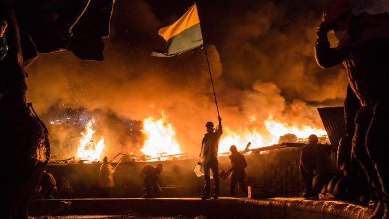 Anti-government protesters guard the perimeter of Independence Square, known as Maidan