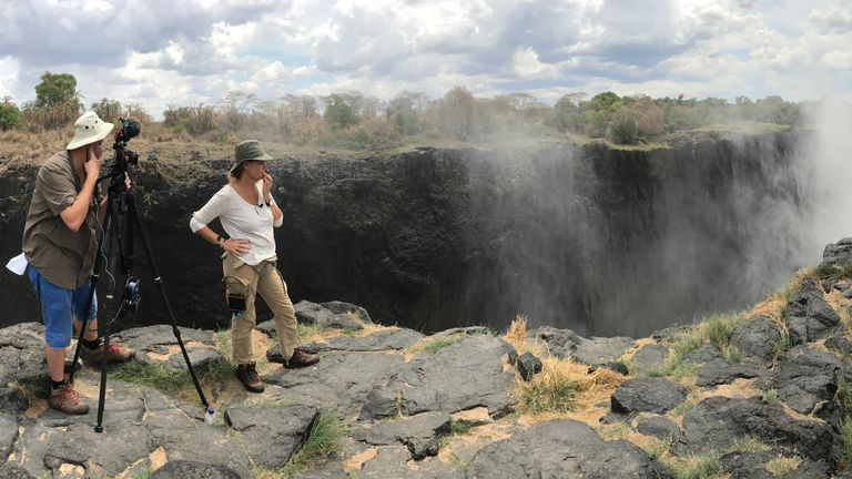 Alex Crawford and her cameraman film at the Victoria Falls