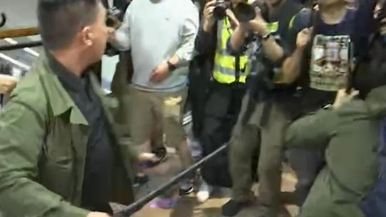 Violence erupts in Hong Kong shopping centre as protesters attack other people and police