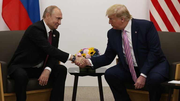 Vladimir Putin and Donald Trump shake hands at the G20 summit in Japan in June 2019