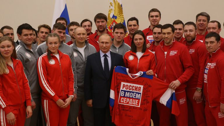 Russian president Vladimir Putin, centre, with 2018 Winter Olympics athletes