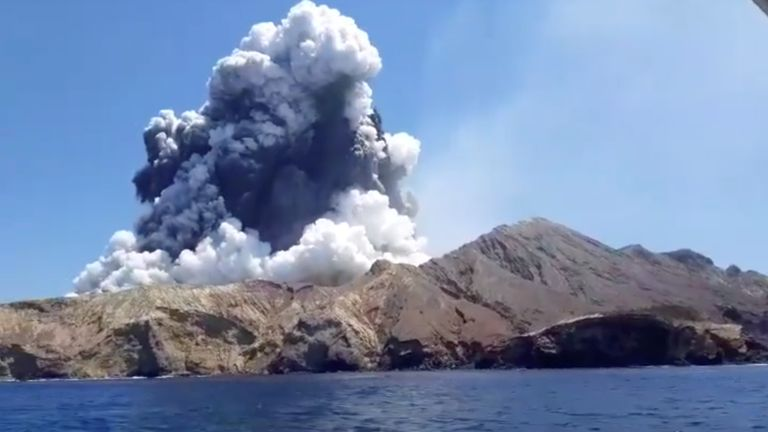 Smoke from the volcanic eruption of White Island is pictured from a boat