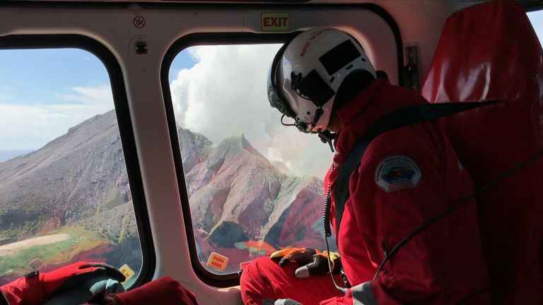 First responders filmed their approach to the White Island volcano in a helicopter, including landing on the ash-covered surface