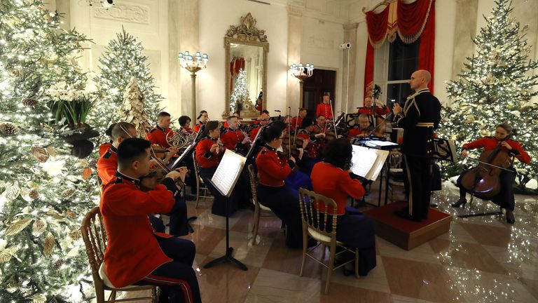 A military band plays Christmas music in the Grand Foyer at the White House
