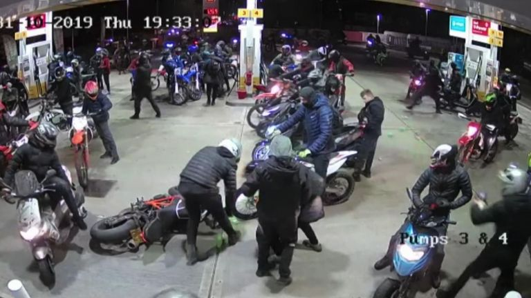 Bikers swarm over a petrol station forecourt in Manchester
