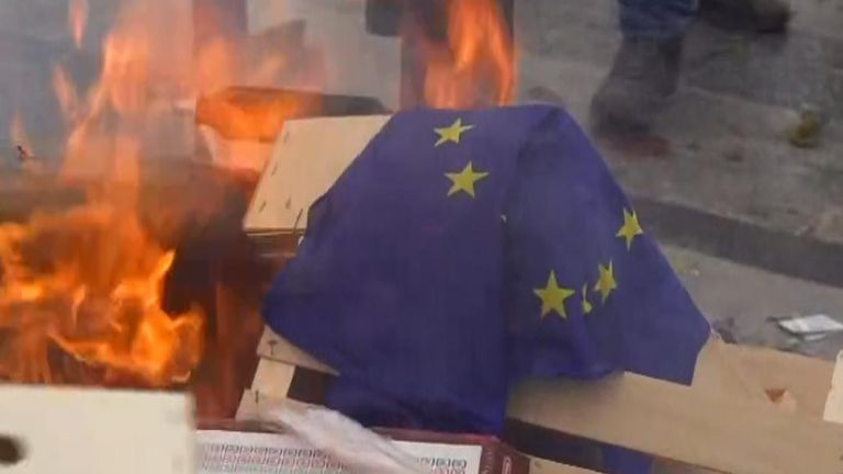 Yellow Vest activists set the EU flag alight during a protest against pension reform.