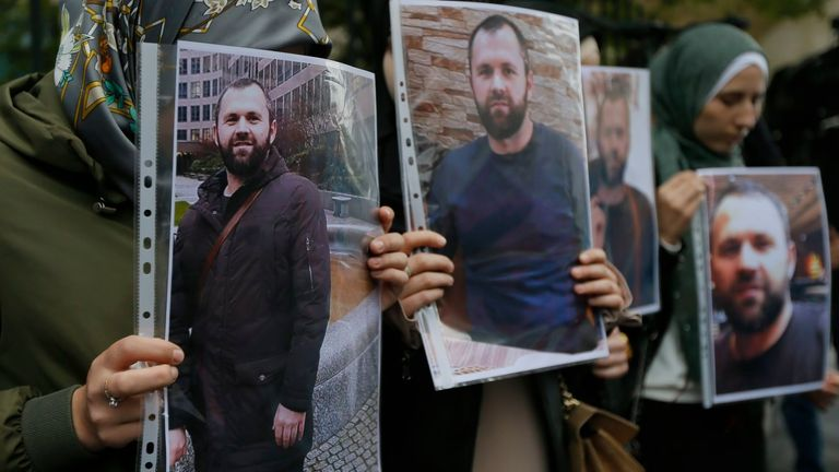 People hold portraits of Zelimkhan Khangoshvili in front of the German embassy in Tbilisi, Georgia