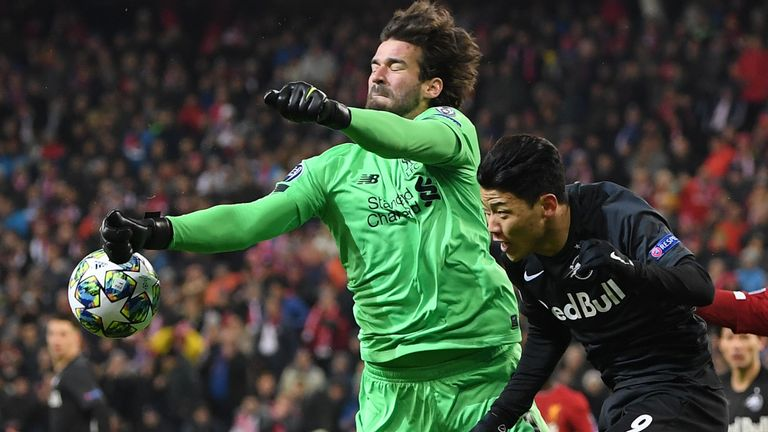 Alisson beats Red Bull Salzburg's Hwang to the ball