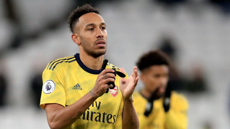 """Arsenal's Pierre-Emerick Aubameyang applauds the fans after the final whistle during the Premier League match at the London Stadium, London. PA Photo. Picture date: Monday December 9, 2019. See PA story SOCCER West Ham. Photo credit should read: Adam Davy/PA Wire. RESTRICTIONS: EDITORIAL USE ONLY No use with unauthorised audio, video, data, fixture lists, club/league logos or """"live"""" services. Online in-match use limited to 120 images, no video emulation. No use in betting, games or single club/league/player publications."""