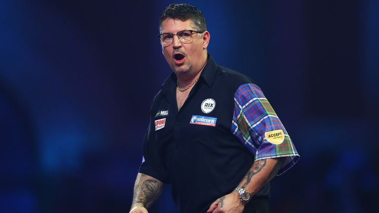 Gary Anderson of Scotland celebrates during his fourth round match against Nathan Aspinall of England on Day 12 of the 2020 William Hill World Darts Championship at Alexandra Palace on December 27, 2019 in London, England.