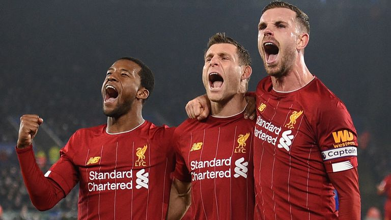James Milner celebrates his goal with Liverpool's Jordan Henderson and Georginio Wijnaldum