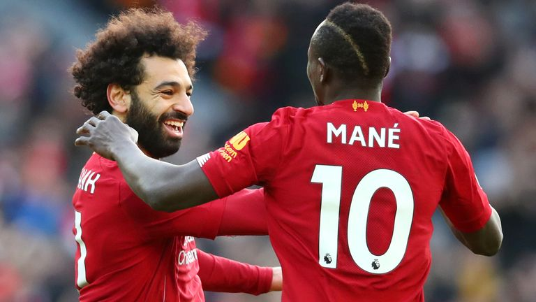 Mohamed Salah celebrates his goal with Sadio Mane