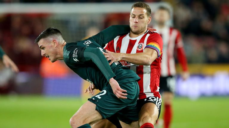 Ciaran Clark holds off Billy Sharp