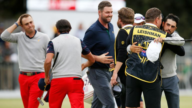 Marc Leishman of Australia and the International team and Abraham Ancer of Mexico and the International team celebrate after halving their match against Justin Thomas of the United States team and Rickie Fowler of the United States team during Saturday afternoon foursomes matches on day three of the 2019 Presidents Cup at Royal Melbourne Golf Course