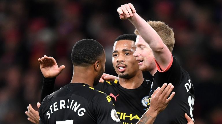 Raheem Sterling celebrates scoring for Manchester City against Arsenal with Gabriel Jesus and Kevin De Bruyne