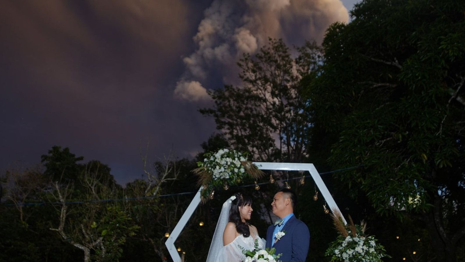 Couple get married despite volcano erupting nearby