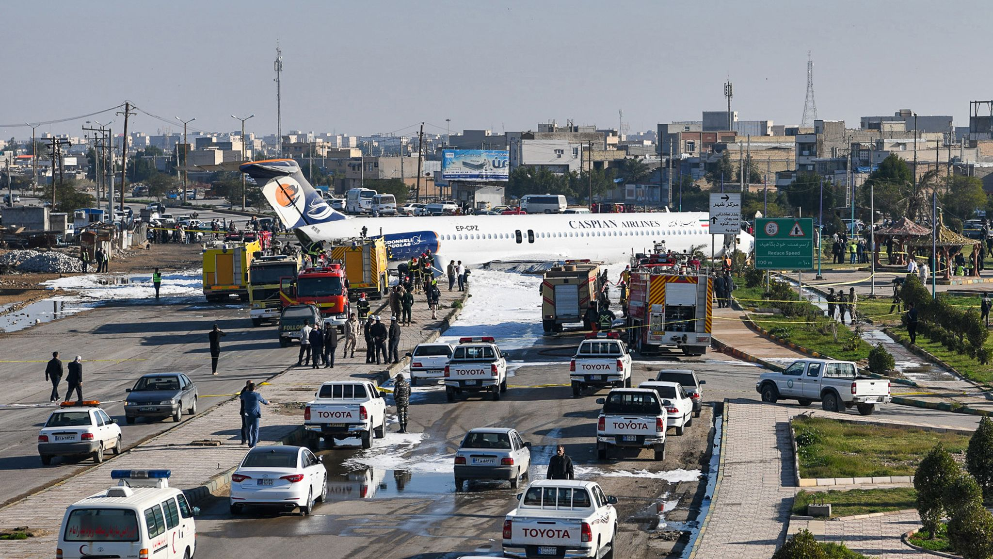 Passenger plane skids off runway onto nearby street in Iran