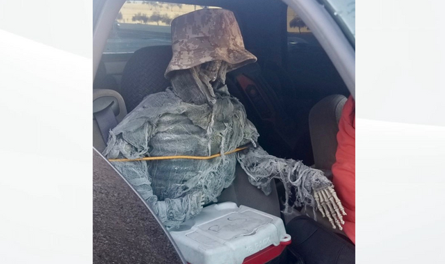 Police have bone to pick with motorist using fake skeleton as a passenger