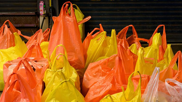 This photograph taken on September 24, 2019 shows plastic bags full of merchandise at Chatuchak market in Bangkok. (Photo by Mladen ANTONOV / AFP)        (Photo credit should read MLADEN ANTONOV/AFP via Getty Images)