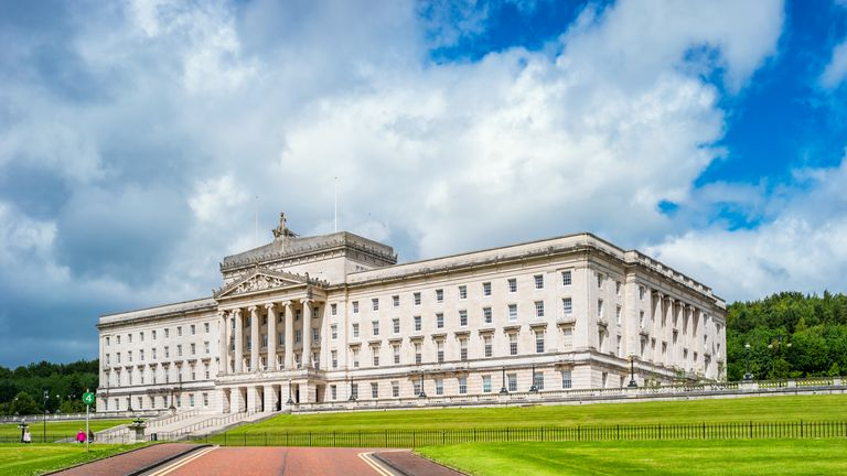 Stock photograph of the facade of the Parliament Buildings in Belfast Northern Ireland, United Kingdom on a sunny day.