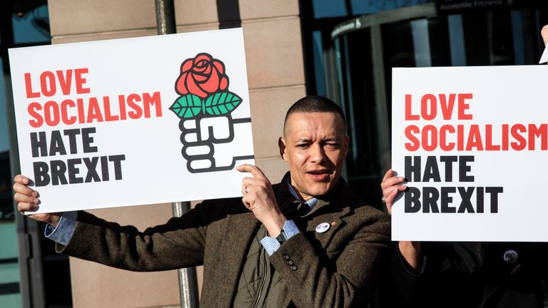 LONDON, ENGLAND - MARCH 05: Labour MP Clive Lewis holds a placard during a demonstration by Labour MPs against Brexit outside Portcullis House on March 5, 2019 in London, England. Government Ministers continue to seek legally-binding changes to Theresa May's Brexit deal in order to get backing from MPs when they vote on the deal in Parliament next week. (Photo by Jack Taylor/Getty Images)