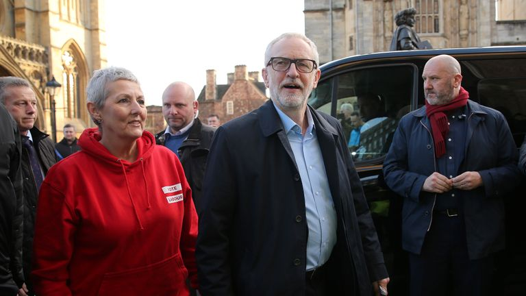 Britain's opposition Labour party leader Jeremy Corbyn (C) arrives with Labour Party General Secretary Jennie Formby (L), to address a general election campaign rally on College Green in Bristol, southwest England, on December 9, 2019. - Britain will go to the polls on December 12, 2019 to vote in a pre-Christmas general election. (Photo by Isabel Infantes / AFP) (Photo by ISABEL INFANTES/AFP via Getty Images)