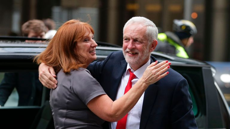 Britain's opposition Labour party Leader Jeremy Corbyn (R) embraces a member of his team Karie Murphy (L) as he arrives at Labour Party headquarters in central London on June 9, 2017 after results in a snap general election showing a hung parliament with Labour gains and the Conservatives losing its majority. British Prime Minister Theresa May faced pressure to resign on Friday after losing her parliamentary majority, plunging the country into uncertainty as Brexit talks loom. The pound fell sharply amid fears the Conservative leader will be unable to form a government and could even be forced out of office after a troubled campaign overshadowed by two terror attacks. / AFP PHOTO / Daniel LEAL-OLIVAS        (Photo credit should read DANIEL LEAL-OLIVAS/AFP via Getty Images)