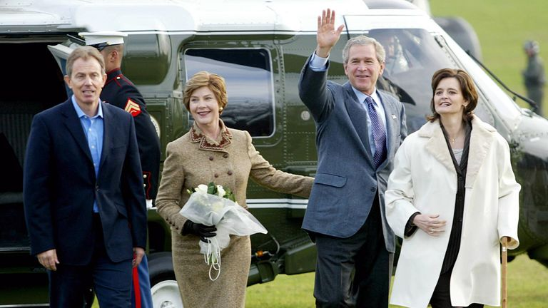 US President George W. Bush (2ndR) and First Lady Laura Bush (2ndL) walk with Prime Minister Tony Blair and his wife Cherie after landing on a field in Marine One behind the Blairs private residence 21 November 2003 in London, England. Bush is finishing a four-day state visit to Britain today and will return to Washington this evening.    AFP PHOTO / TIM SLOAN (Photo by Tim SLOAN / AFP) (Photo by TIM SLOAN/AFP via Getty Images)