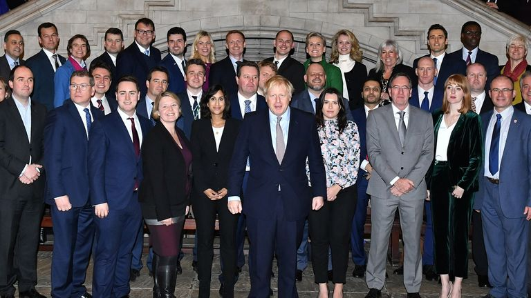 Prime Minister Boris Johnson alongside the newly elected Conservative MPs at the Houses of Parliament in Westminster, London, after the party gained an 80-seat majority in the General Election.