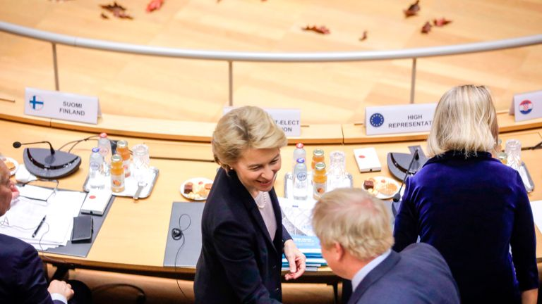 British Prime Minister Boris Johnson (front R) greets Incoming European Commission President Ursula von der Leyen during a round table meeting as part of a European Union summit at European Union Headquarters in Brussels on October 17, 2019. - Britain and the European Union reached a new divorce deal on October 17, 2019 that could allow Brexit on October 31, but faced immediate opposition among MPs in London -- who can still block it. (Photo by Olivier Matthys / POOL / AFP) (Photo by OLIVIER MATTHYS/POOL/AFP via Getty Images)