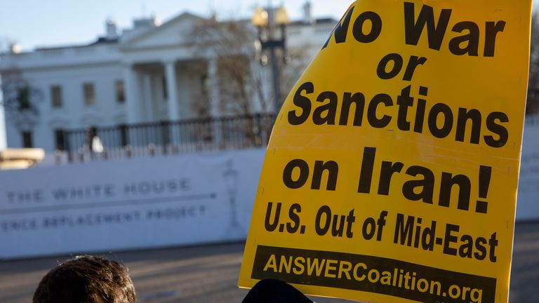 WASHINGTON, DC - JANUARY 08: Anti-war protestors stand outside of the White House on January 8, 2020 in Washington, DC. Protesters have gathered to speak out against escalation towards Iran following the U.S. killing of Iranian General Qasem Soleimani and Iran's retaliatory missile attacks against two U.S.military bases in Iraq. (Photo by Samuel Corum/Getty Images)