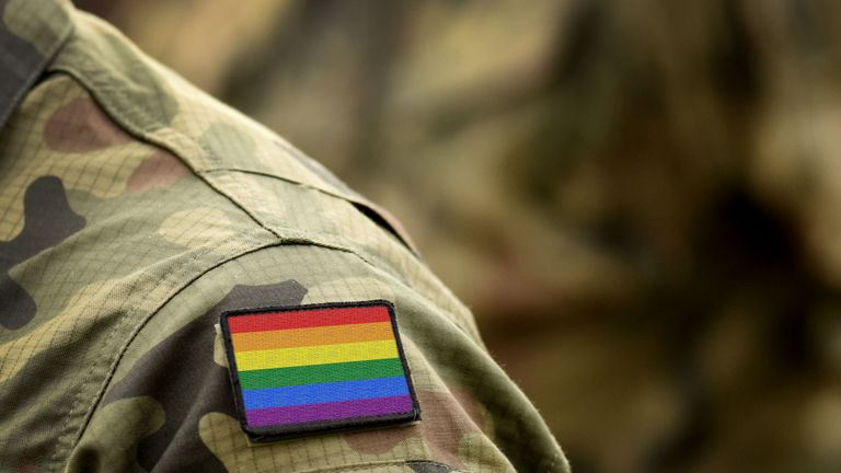 Rainbow flag (LGBT movement) on military uniform. Integration of homosexuals in the military. Discrimination in army. Collage.