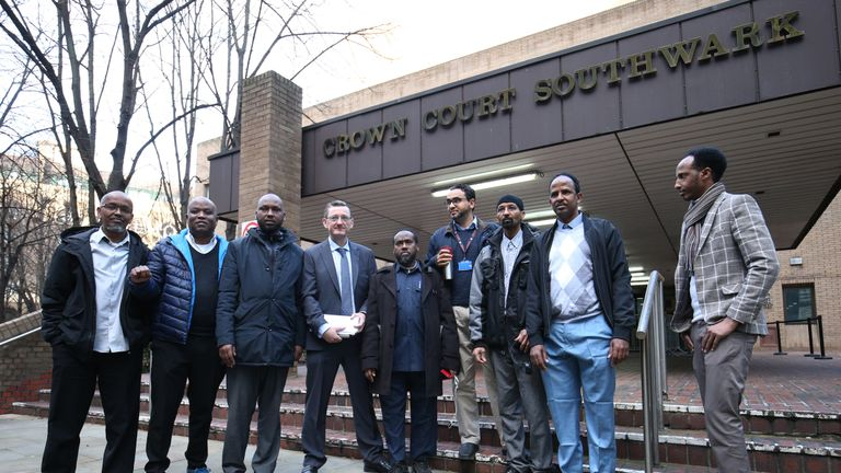 Chair of the United Private Hire Drivers' branch of the IWGB union, James Farrar, (fourth left) is joined by supportive fellow Uber drivers, outside Southwark Crown Court, London, where he on trial accused of assaulting two police officers by using the sound from his megaphone to cause injury, pain and discomfort.