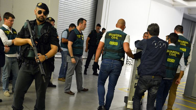 "Spanish Civil Guards push a box containing Picasso's painting ""Head of a Young Woman"" at the Reina Sofia museum in Madrid after being transferred from the French island of Corsica, on August 11, 2015. The Picasso worth more than 25 million euros and owned by the Spanish banker Jaime Botin, was transferred to Reina Sofia museum today after it was seized from a yacht on July 31 by French customs agents who accused the painting's owner of trying to illegally export it to Switzerland. AFP PHOTO / GERARD JULIEN        (Photo credit should read GERARD JULIEN/AFP via Getty Images)"